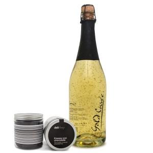 Botella con oro a la vista y envases de Delishop