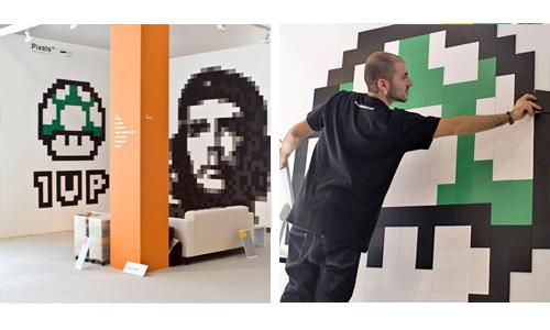 PíxelsXL en la feria con composiciones del Che Guevara pixelado y otras